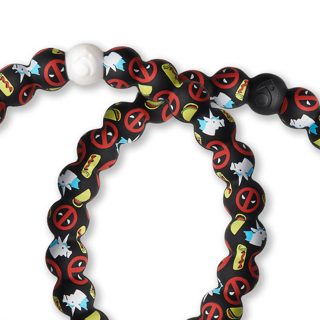 Close up of silicone beaded bracelet with Deadpool pattern.