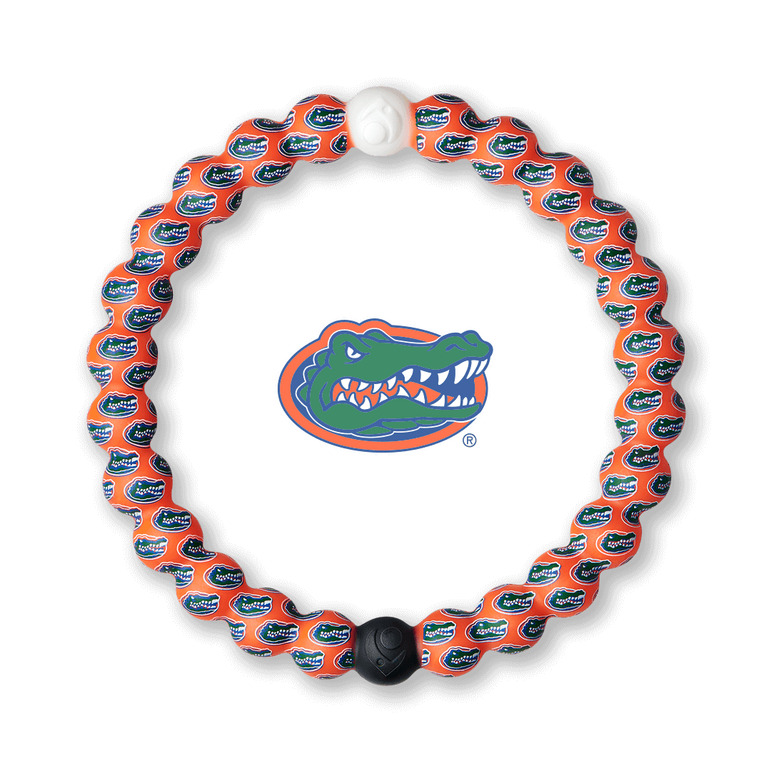 Orange and blue silicone beaded bracelet with the University of Florida logo in the center.
