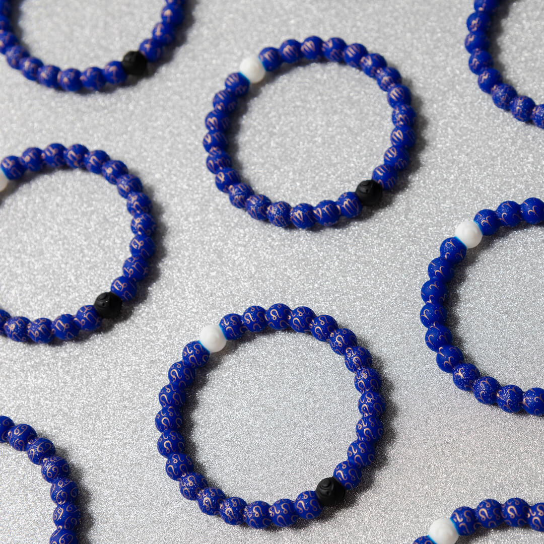 Group shot of various silicone beaded bracelets with zodiac symbol patterns.