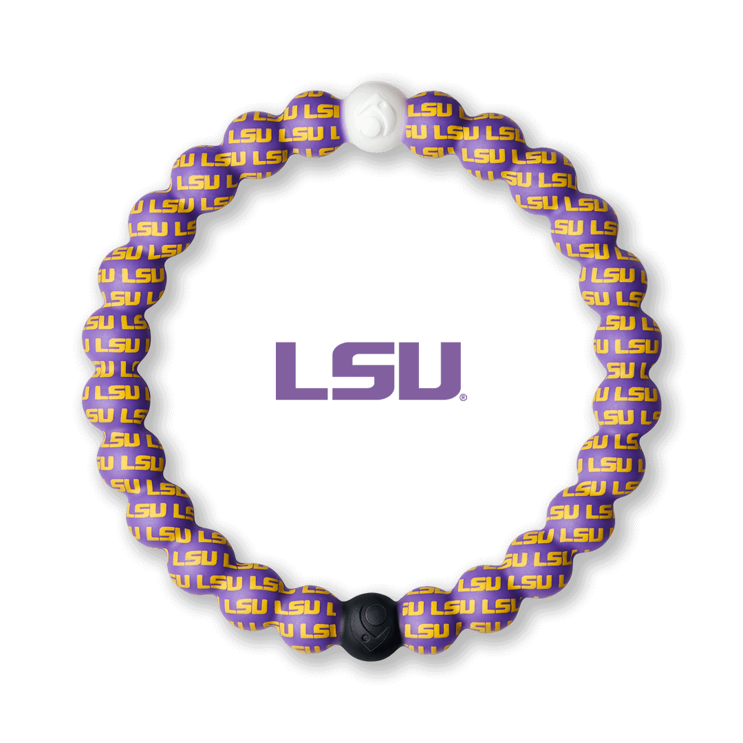 Yellow and purple silicone beaded bracelet with the Louisiana State University logo pattern all over it.