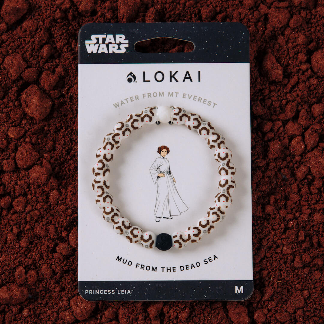 Silicone beaded bracelet with Princess Leia pattern on carded packaging.