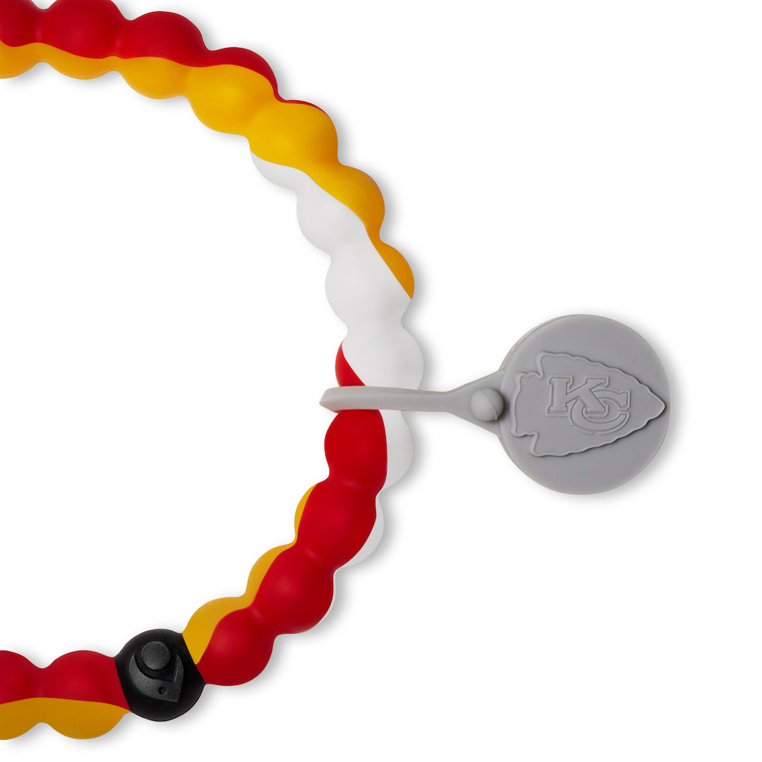 Close up of a red, yellow and white swirls silicone beaded bracelet