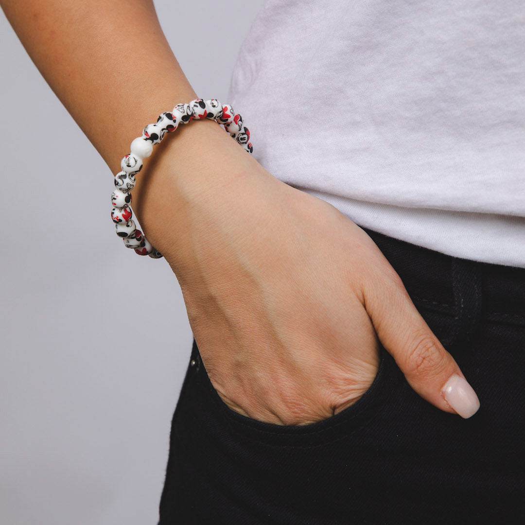 Woman wearing silicone beaded bracelet with Minnie Mouse pattern on wrist