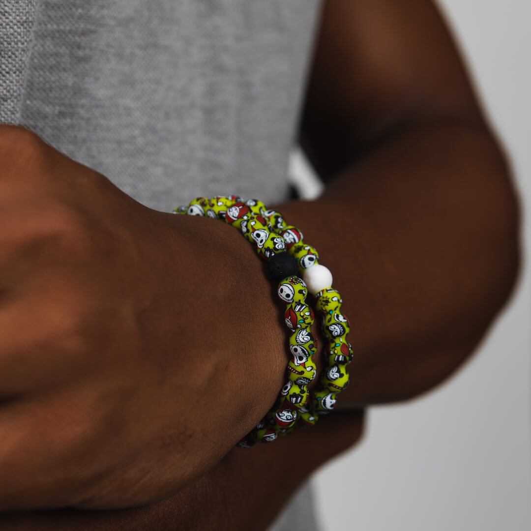 Male wearing christmas themed silicone beaded bracelet with skeleton pattern on wrist
