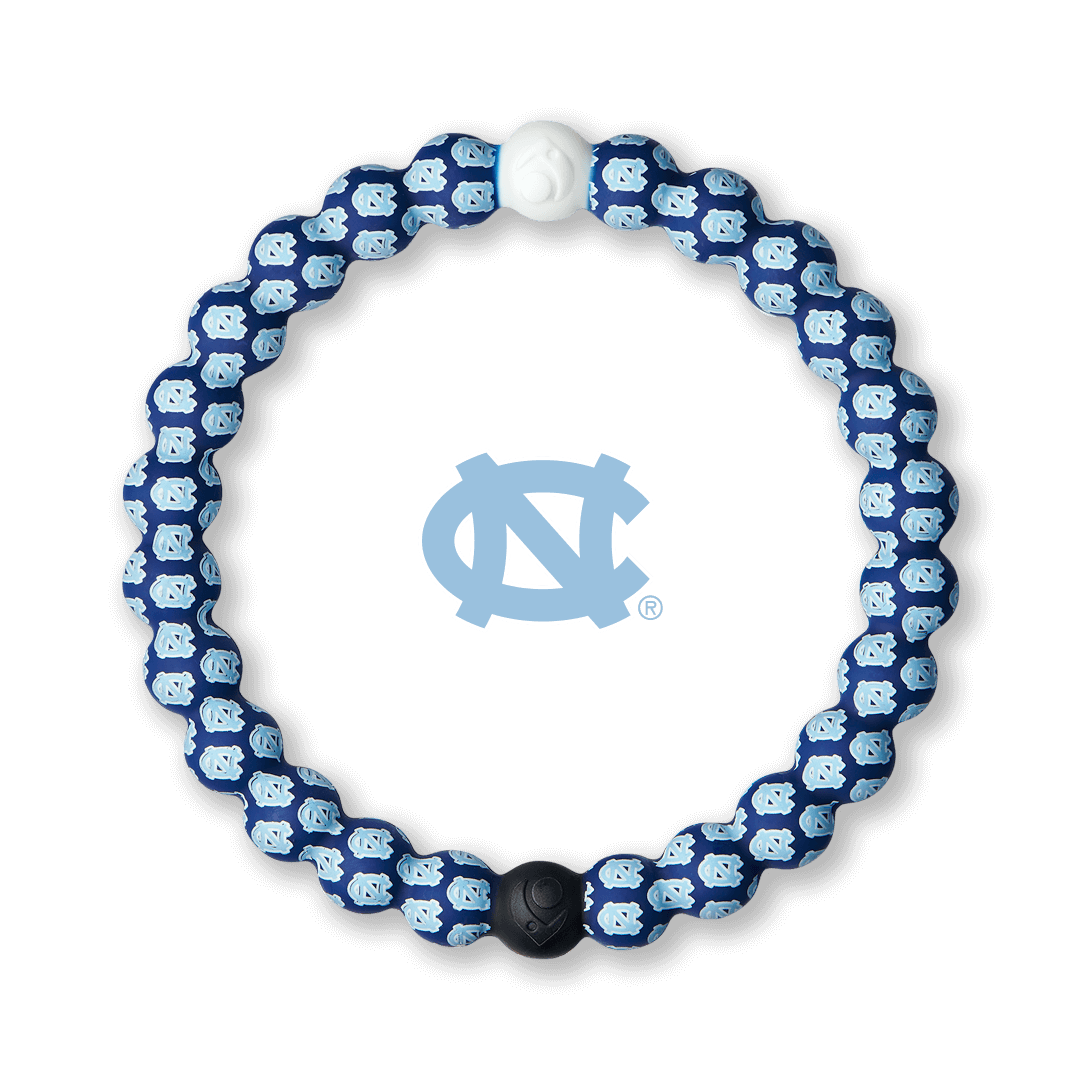 Light blue and navy silicone beaded bracelet with the University of North Carolina logo pattern all over it.