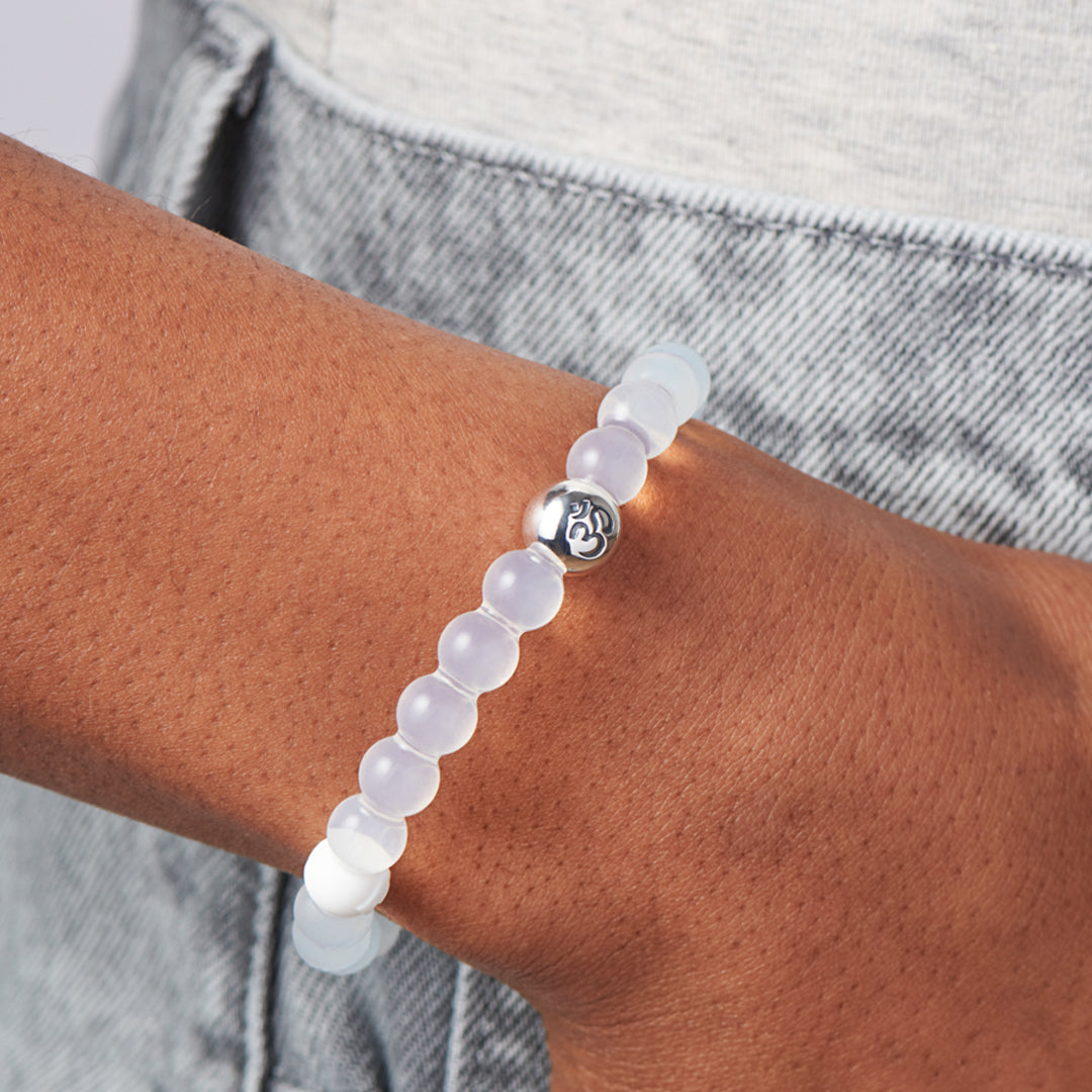 Woman wearing om charm on silicone beaded bracelets