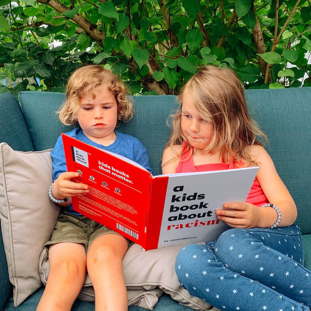 Two kids reading A Kids Book About Racism