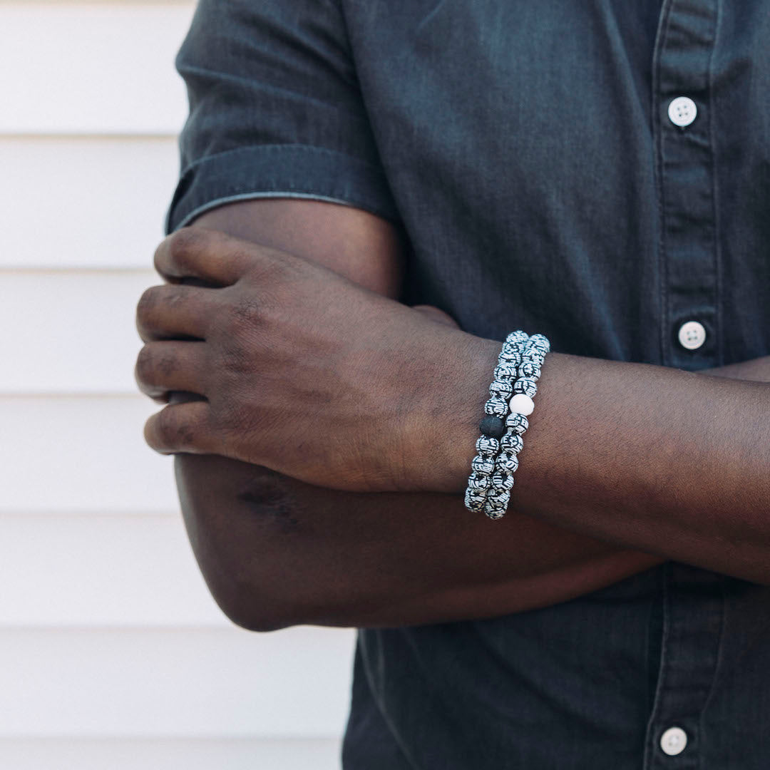 Male wearing black lives matter silicone beaded bracelet on wrist.