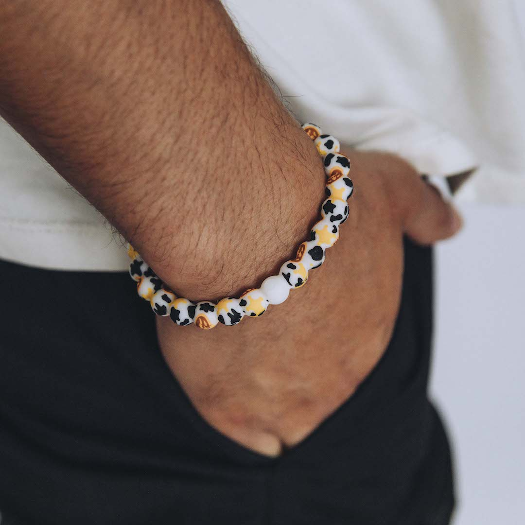 Male wearing silicone beaded bracelet with Sheriff Woody pattern on wrist