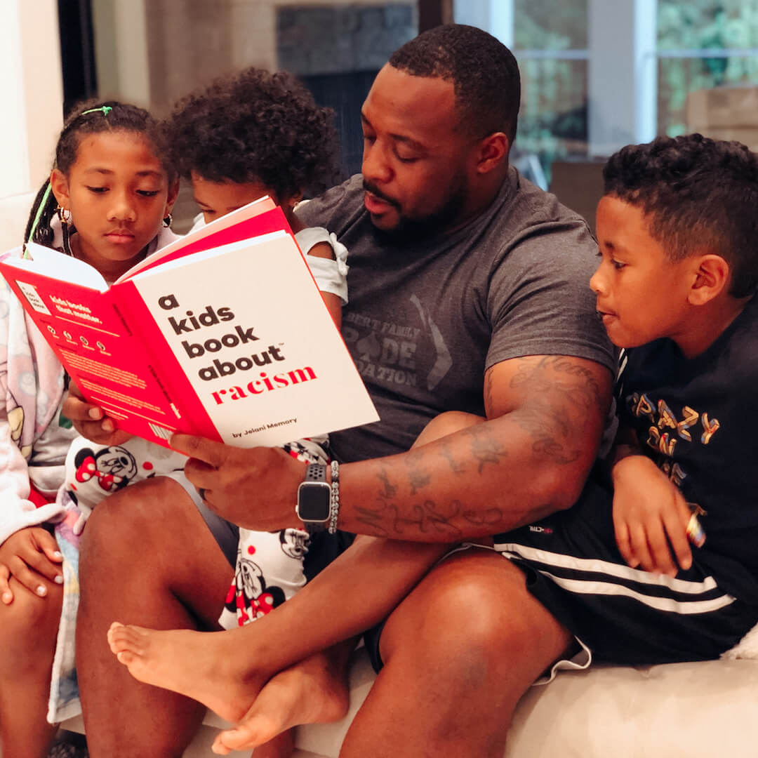 Father reading A Kids Book About Racism to his children