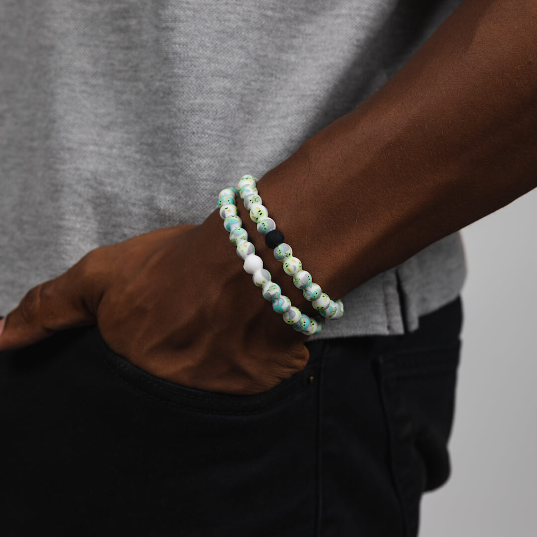 Male wearing a silicone beaded bracelet with The Child pattern on wrist.