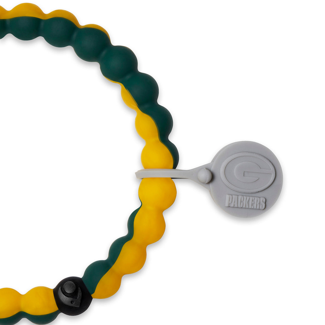 Close up of a green and yellow swirl silicone beaded bracelet