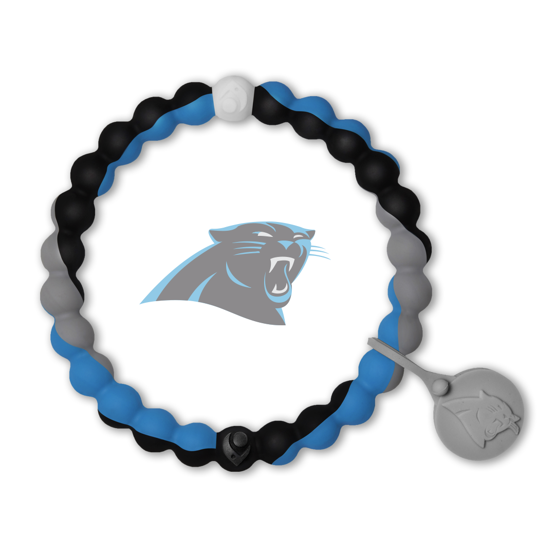 Male wearing a blue, gray and black silicone beaded bracelet on wrist while holding a football.