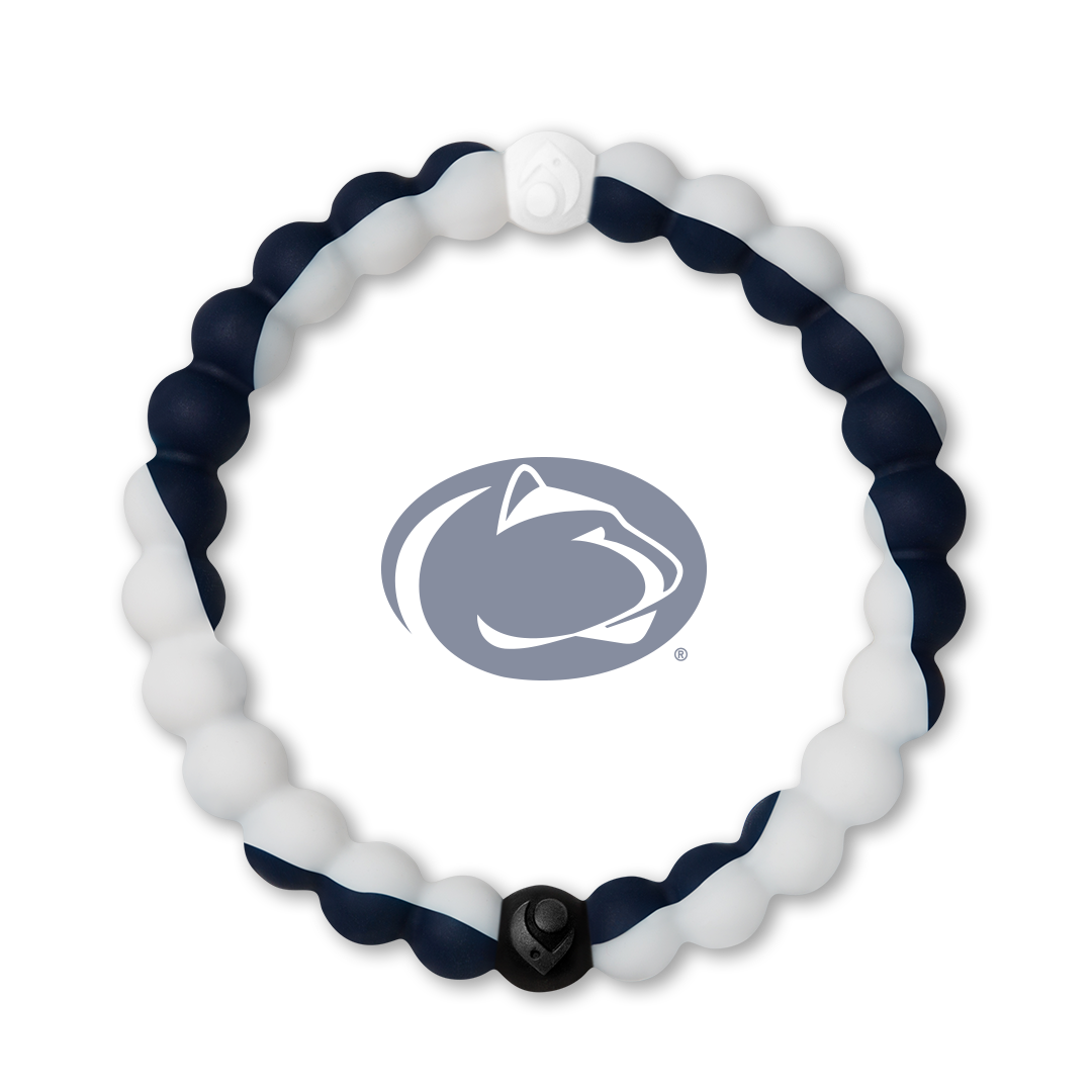 Man holding football wearing a white and navy blue silicone beaded bracelet.