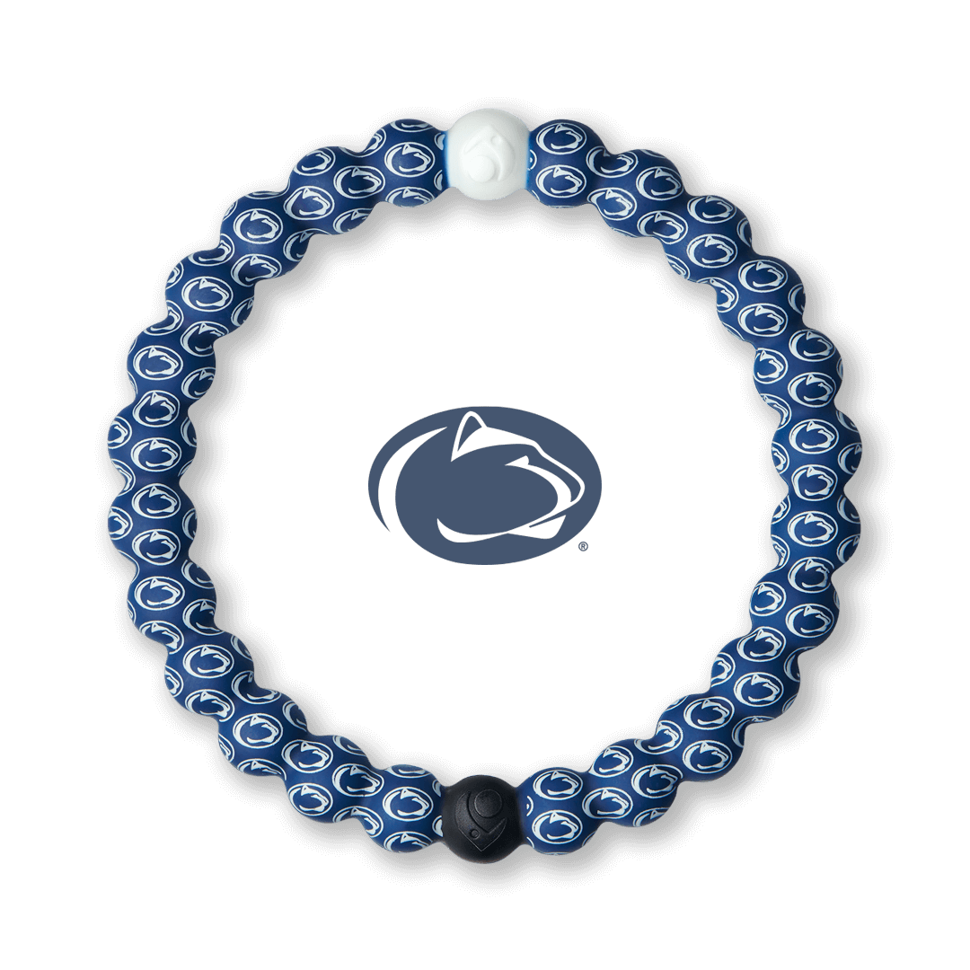 White and navy blue silicone beaded bracelet with the Pennsylvania State University logo all over it.