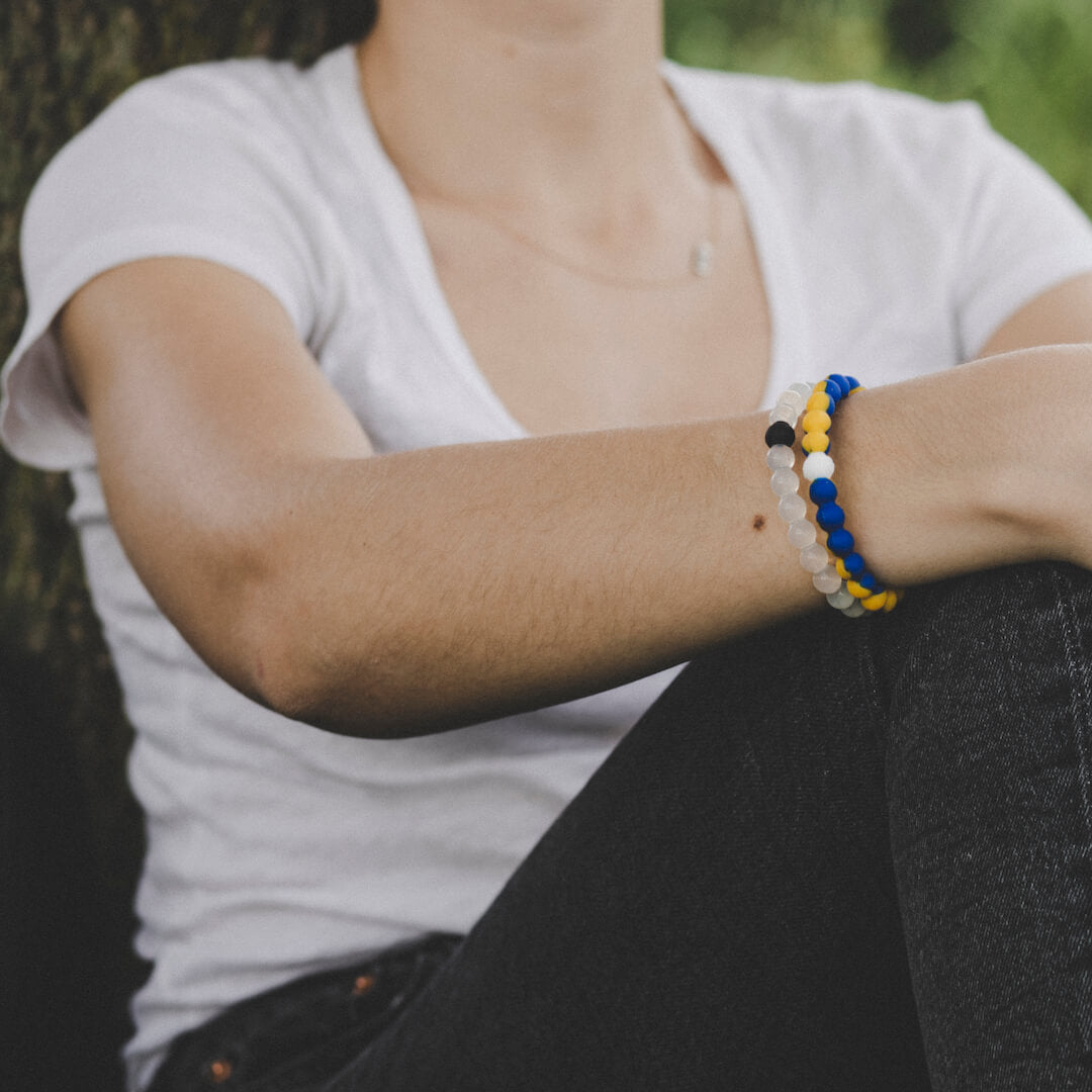 Close-up of blue and yellow silicone beaded bracelet.