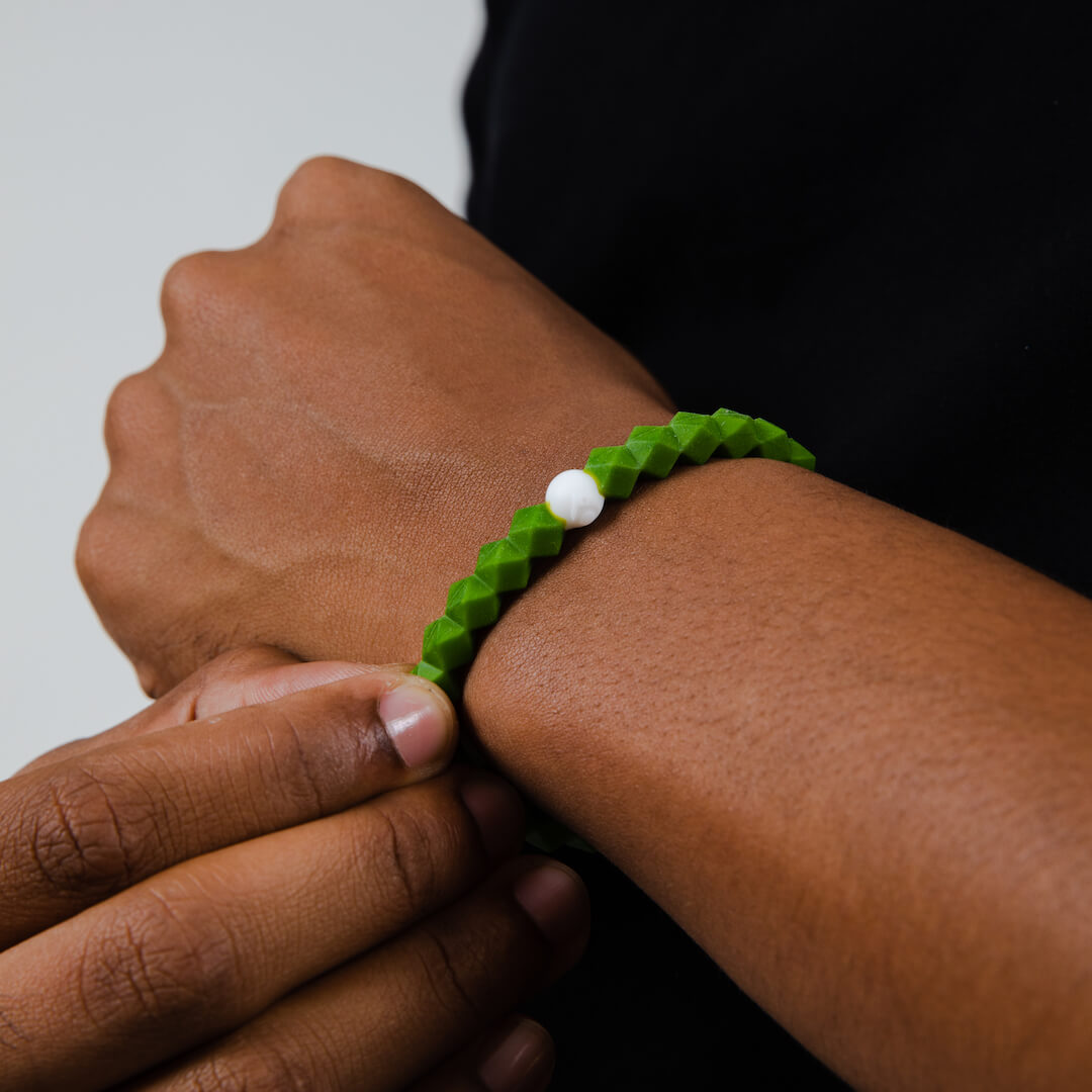 Close up of Forest Green silicone beaded bracelet on wrist.