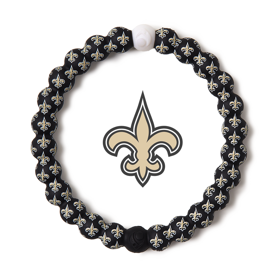 Black, gold and white silicone beaded bracelet with New Orleans Saints team logo in the center.