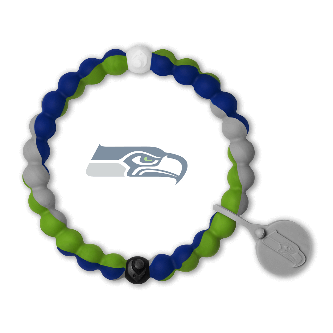 Male wearing a green, gray and blue silicone beaded bracelet on wrist while holding a football.
