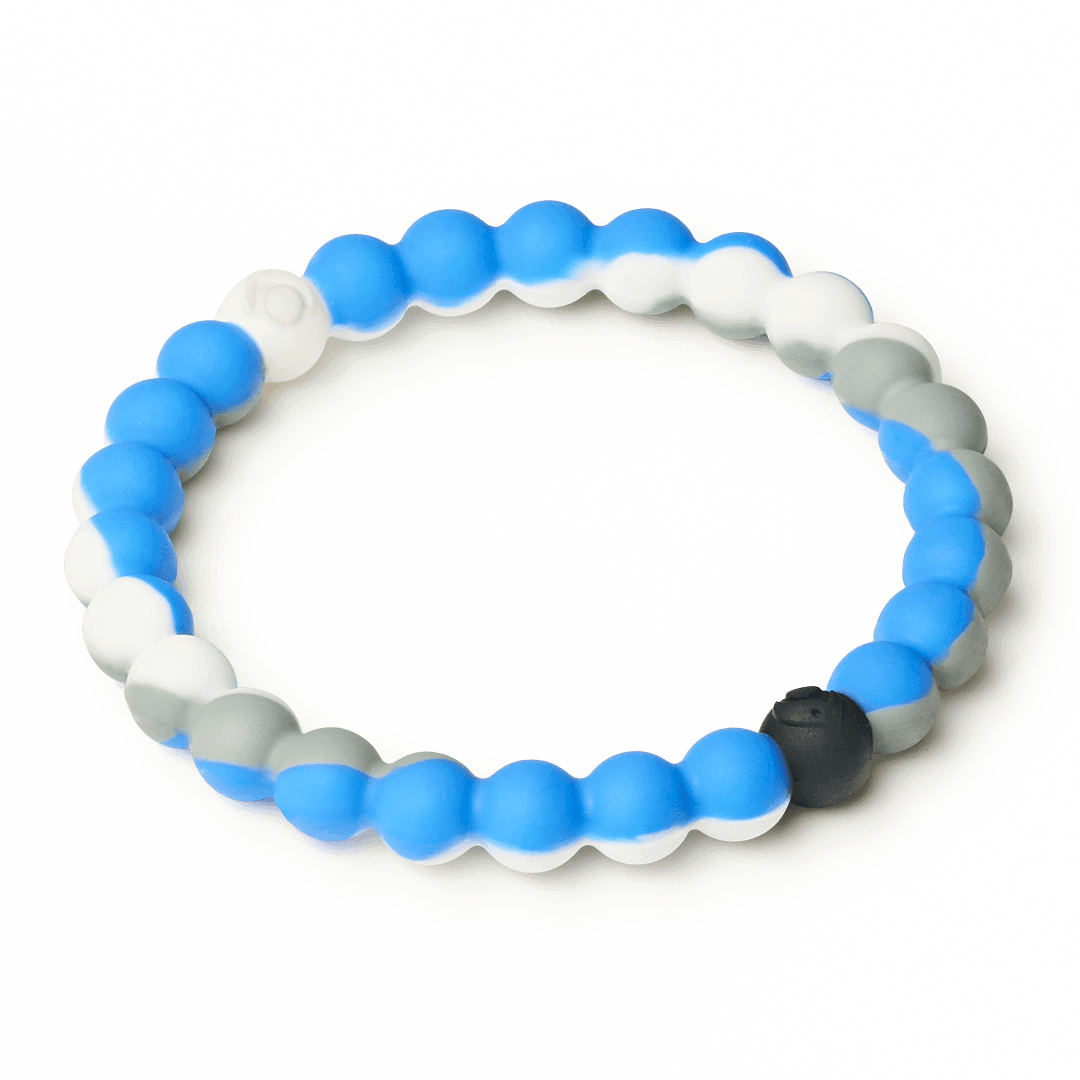 Side angle of blue, gray and white swirl silicone beaded bracelet.