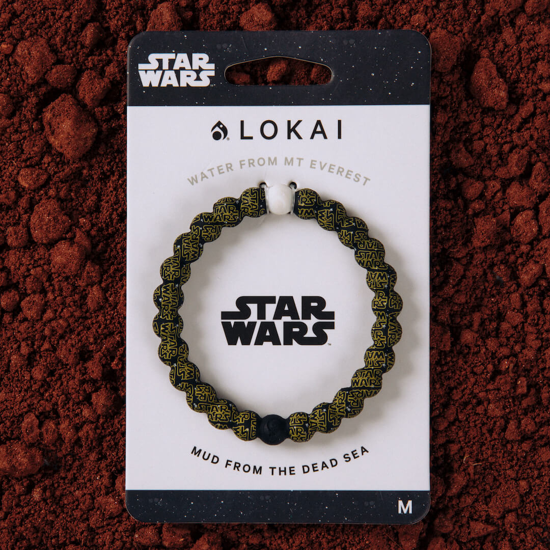 Silicone beaded bracelet with Star Wars logo pattern on carded packaging.