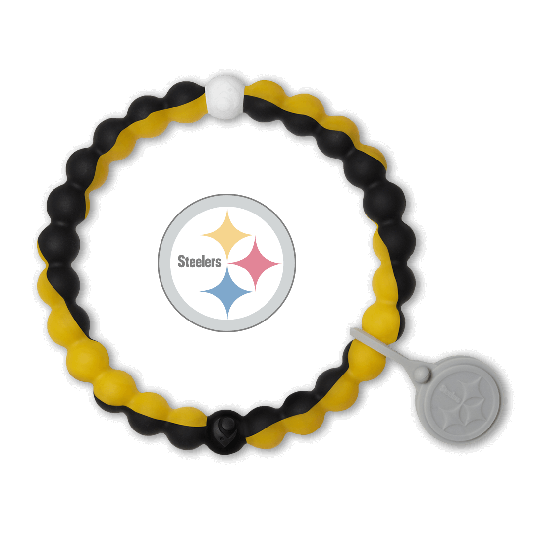 Male wearing a black and yellow silicone beaded bracelet on wrist while holding a football.