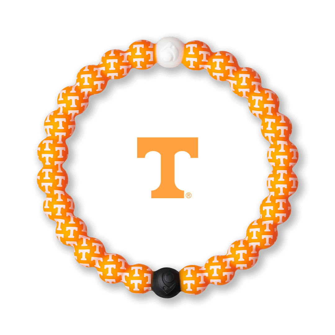 Orange and white silicone beaded bracelet with the University of Tennessee logo pattern all over it.