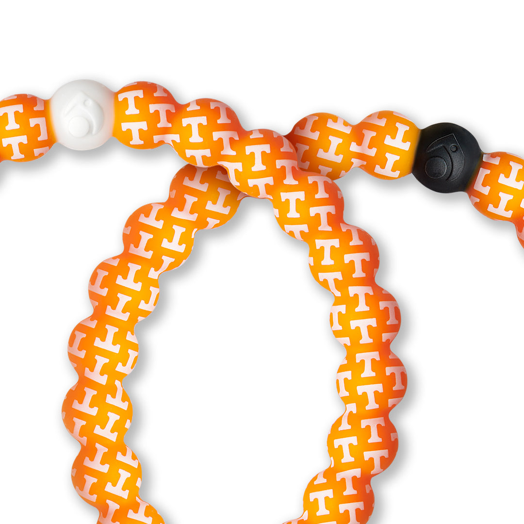Close-up of orange and white silicone beaded bracelet with the University of Tennessee logo pattern all over it.