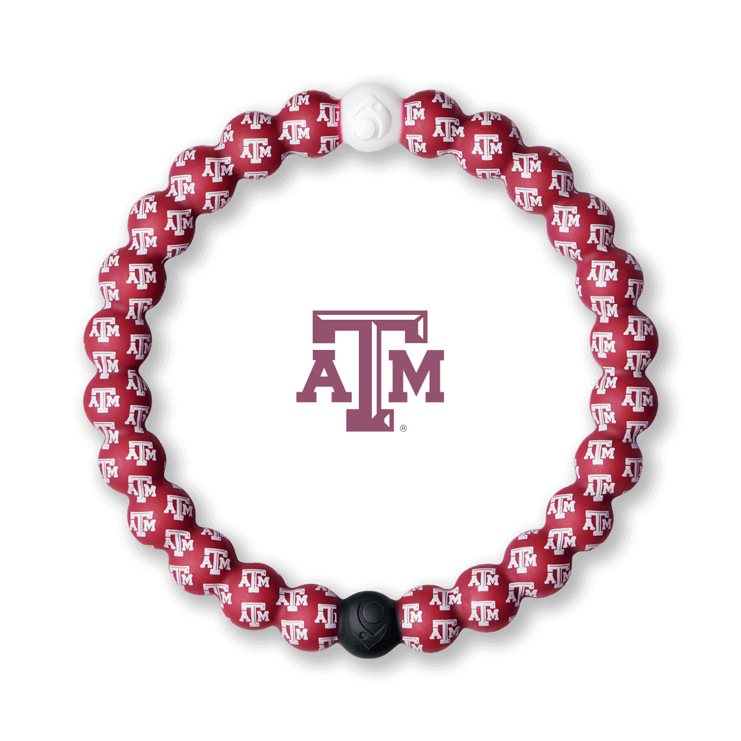 Red and white silicone beaded bracelet with the Texas A & M University logo pattern all over it