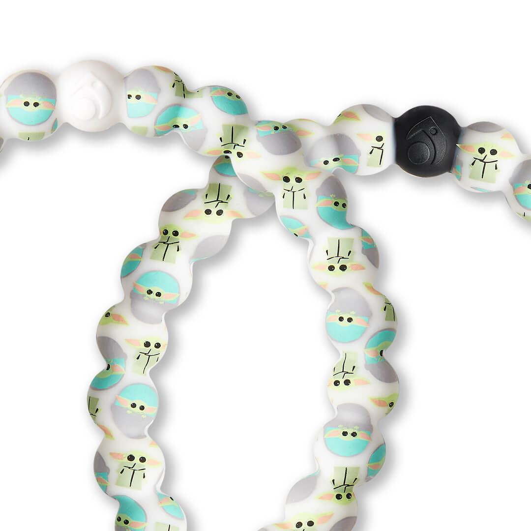 Close up of a silicone beaded bracelet with The Child pattern.