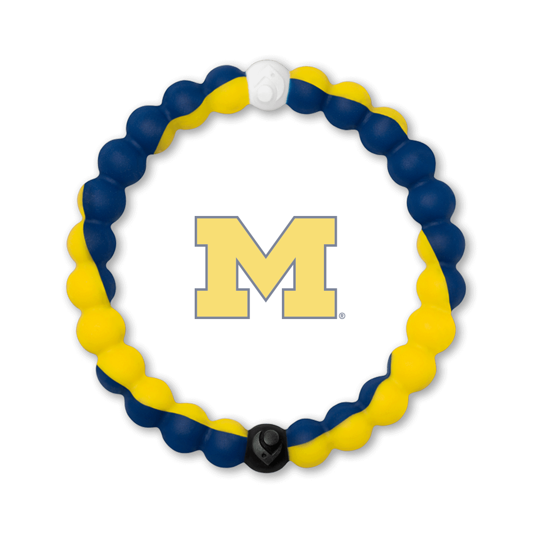 Yellow and dark blue silicone beaded bracelet with the University of Michigan logo in the center.