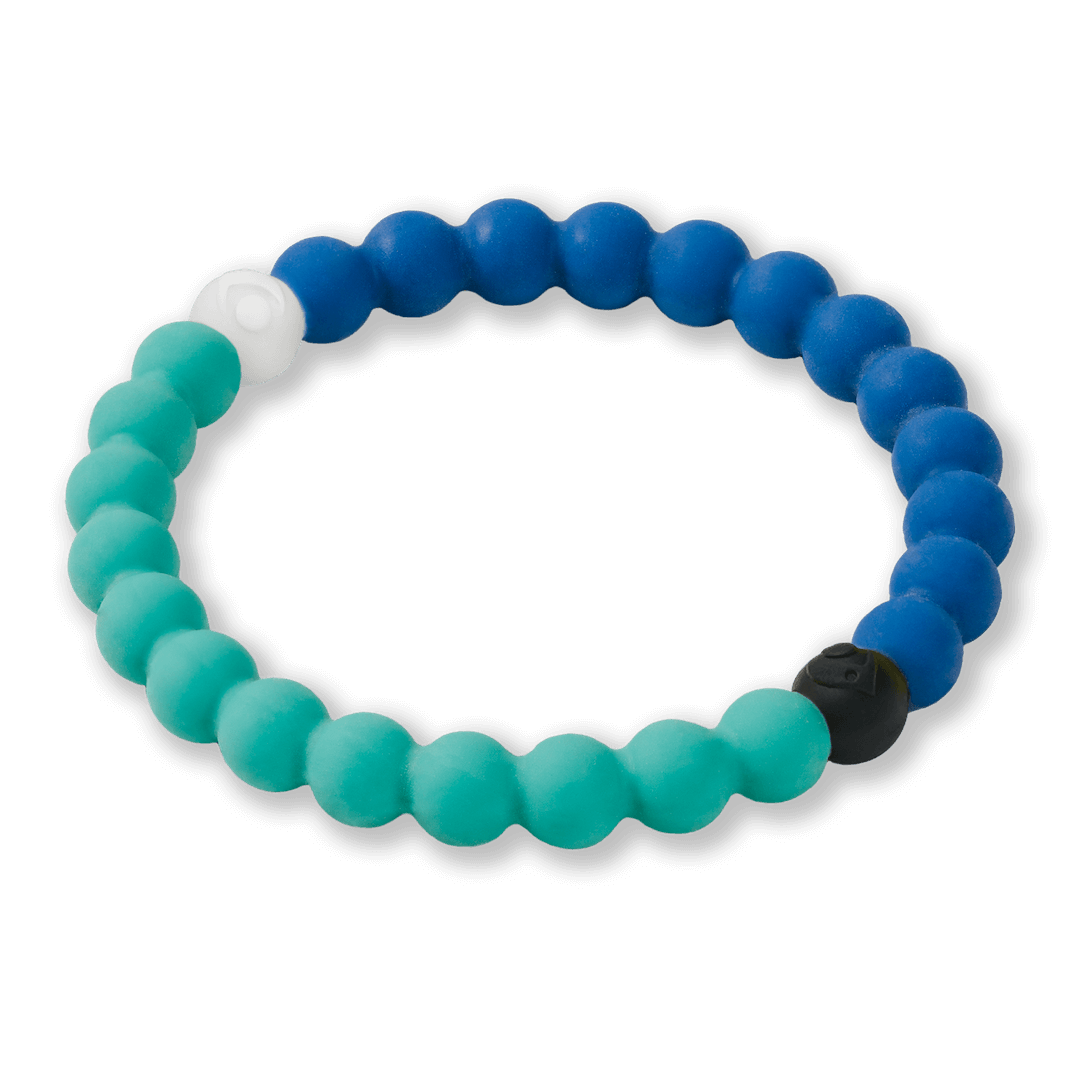 Side angle of split light blue and dark blue silicone beaded bracelet.