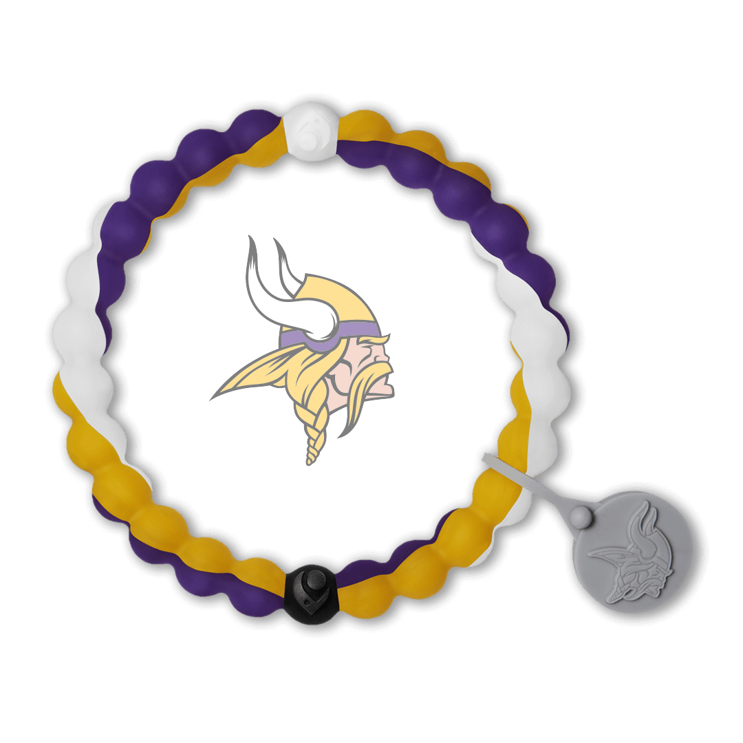 Male wearing a purple, white and yellow silicone beaded bracelet on wrist while holding a football.