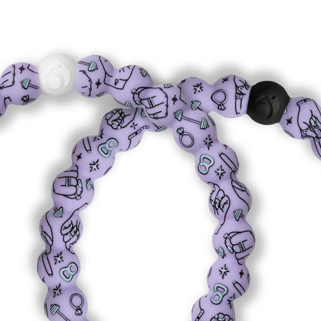 Close up of light purple silicone beaded bracelet with workout equipment icons.