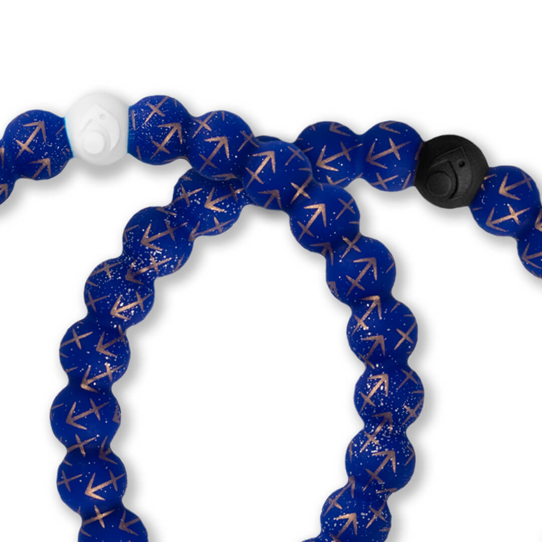 Close up of silicone beaded bracelet with Sagittarius symbol pattern.