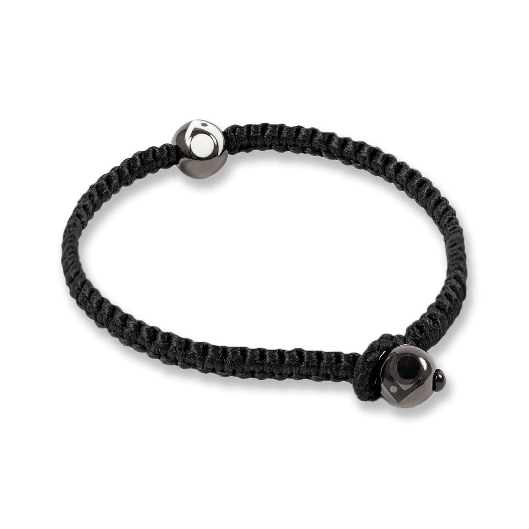 Side angle of black woven bracelet with two gunmetal metal beads.