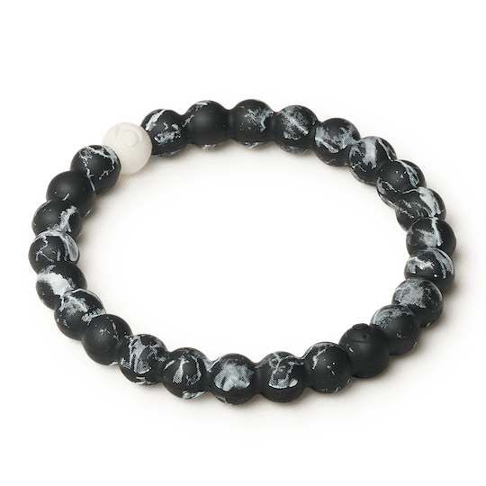 Side angle of black marble silicone beaded bracelet.