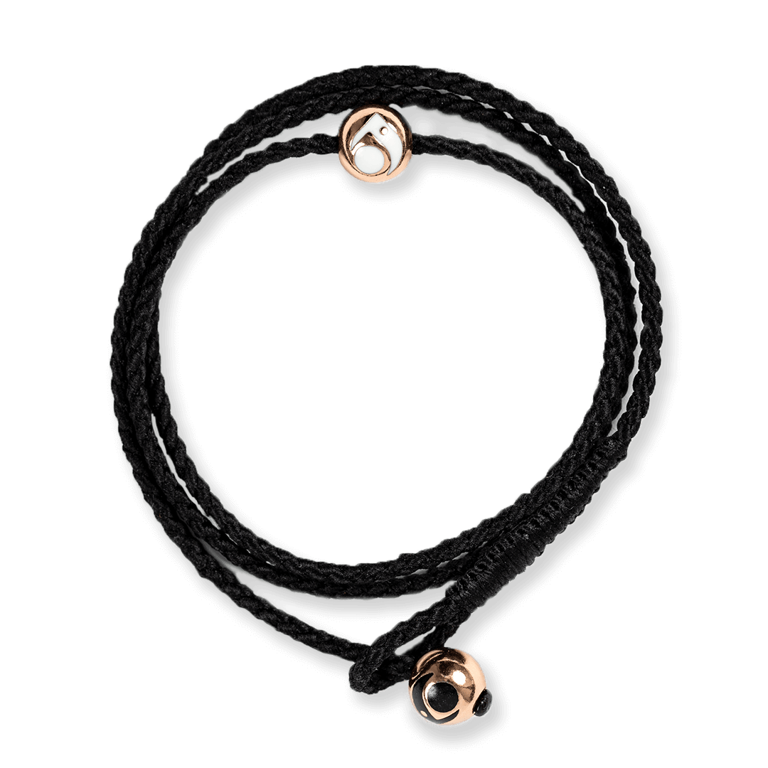 Black triple wrap woven bracelet with two rose gold metal beads.