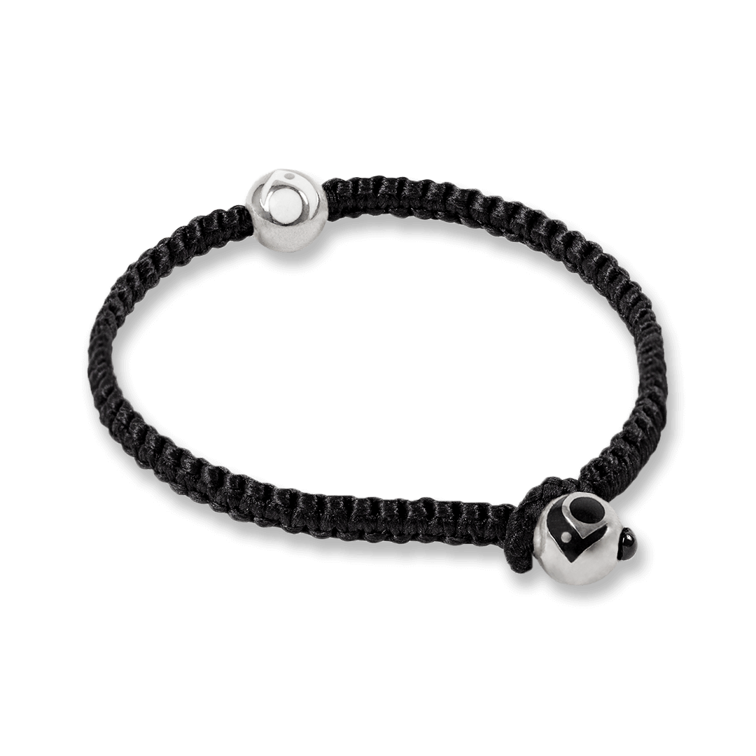 Side angle of black woven bracelet with two silver metal beads.