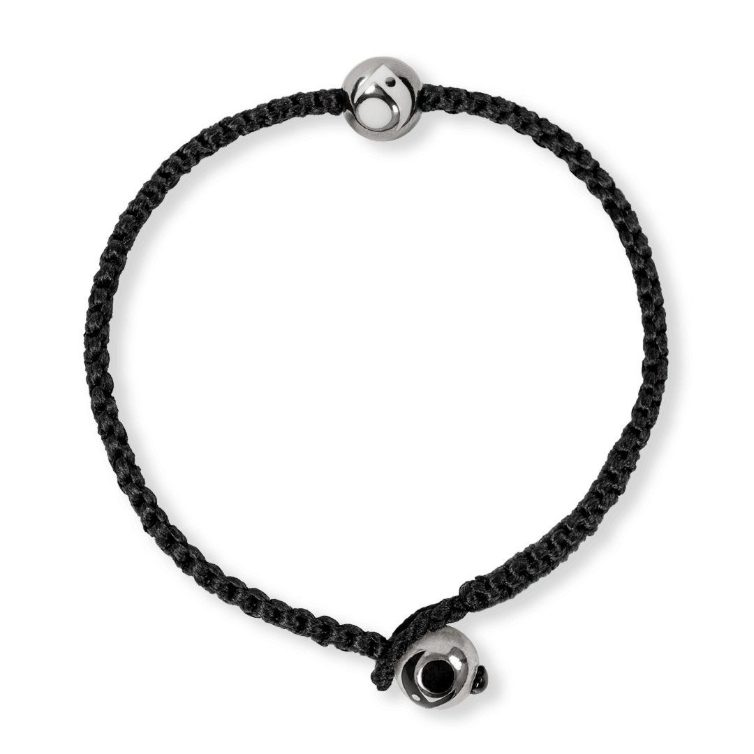 Black woven bracelet with two silver metal beads.