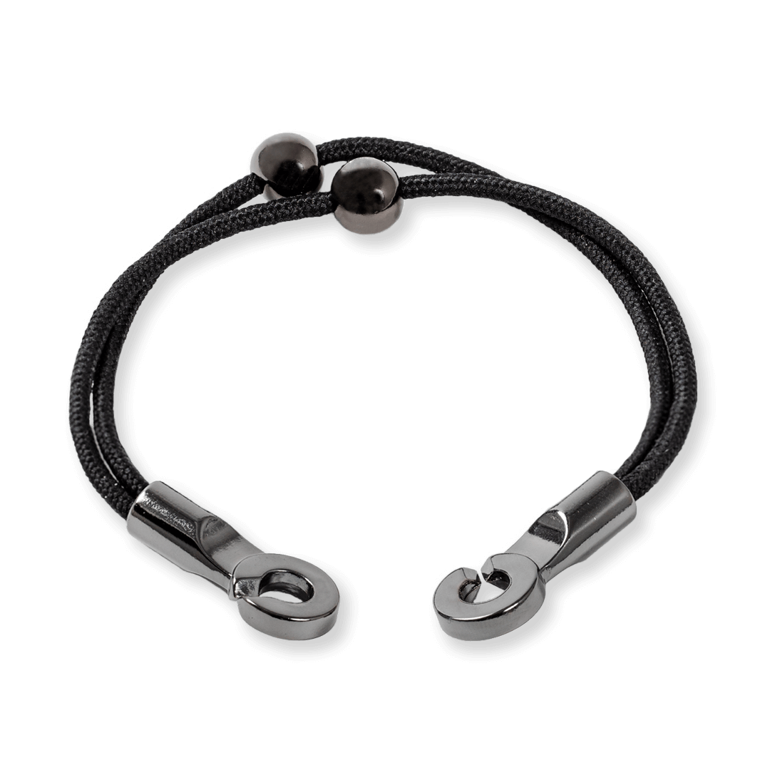 Side angle of black cord bracelet with two gunmetal metal beads and a metal hook closure.