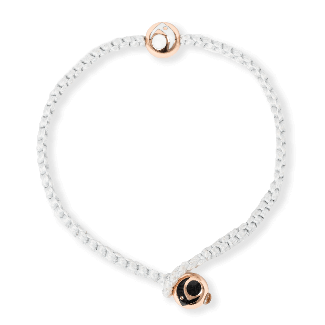 Light gray woven bracelet with two rose gold metal beads.