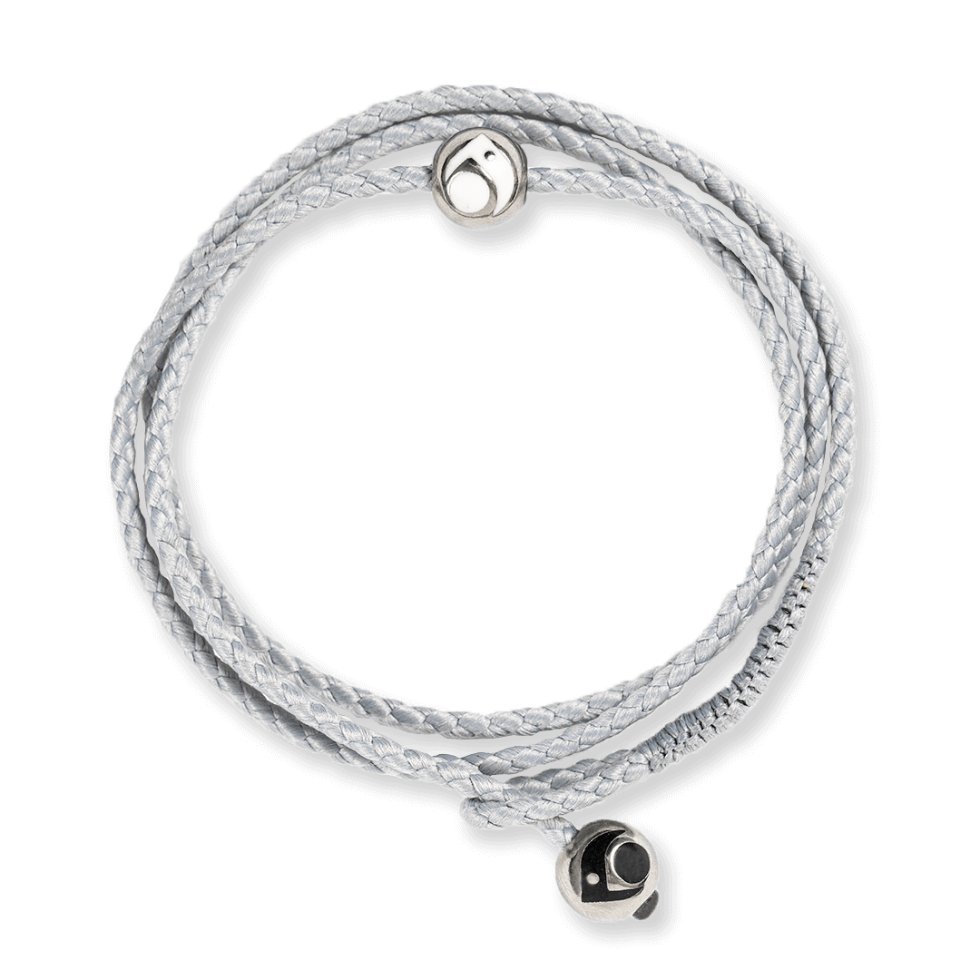 Light gray triple wrap woven bracelet with two silver metal beads.