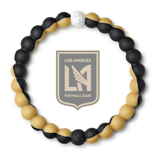 A gold and black swirl silicone beaded bracelet.