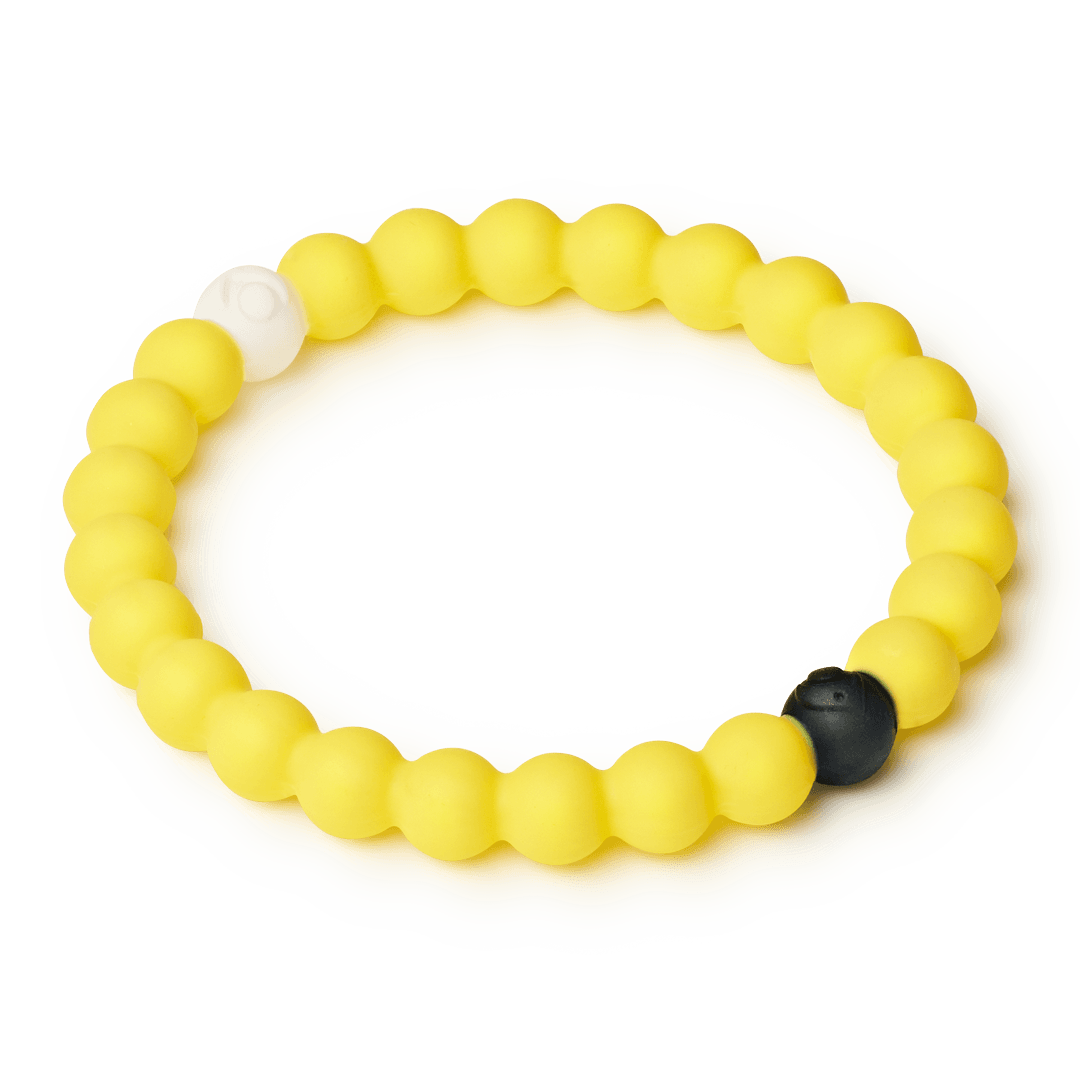 Side angle of yellow silicone beaded bracelet.