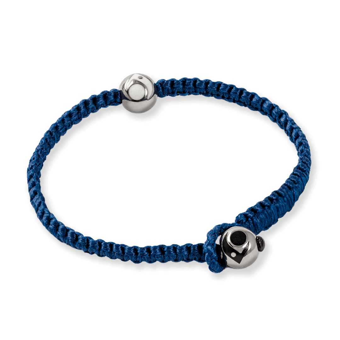 Side angle of navy blue woven bracelet with two silver metal beads.