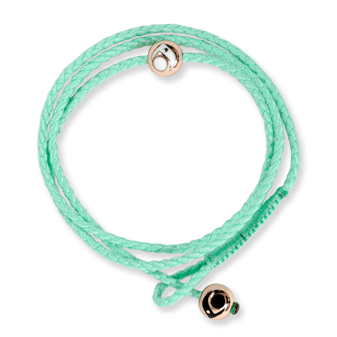 Mint triple wrap woven bracelet with two rose gold metal beads.