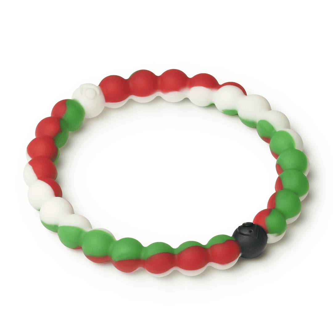 Side angle of red, white and green silicone beaded bracelet.