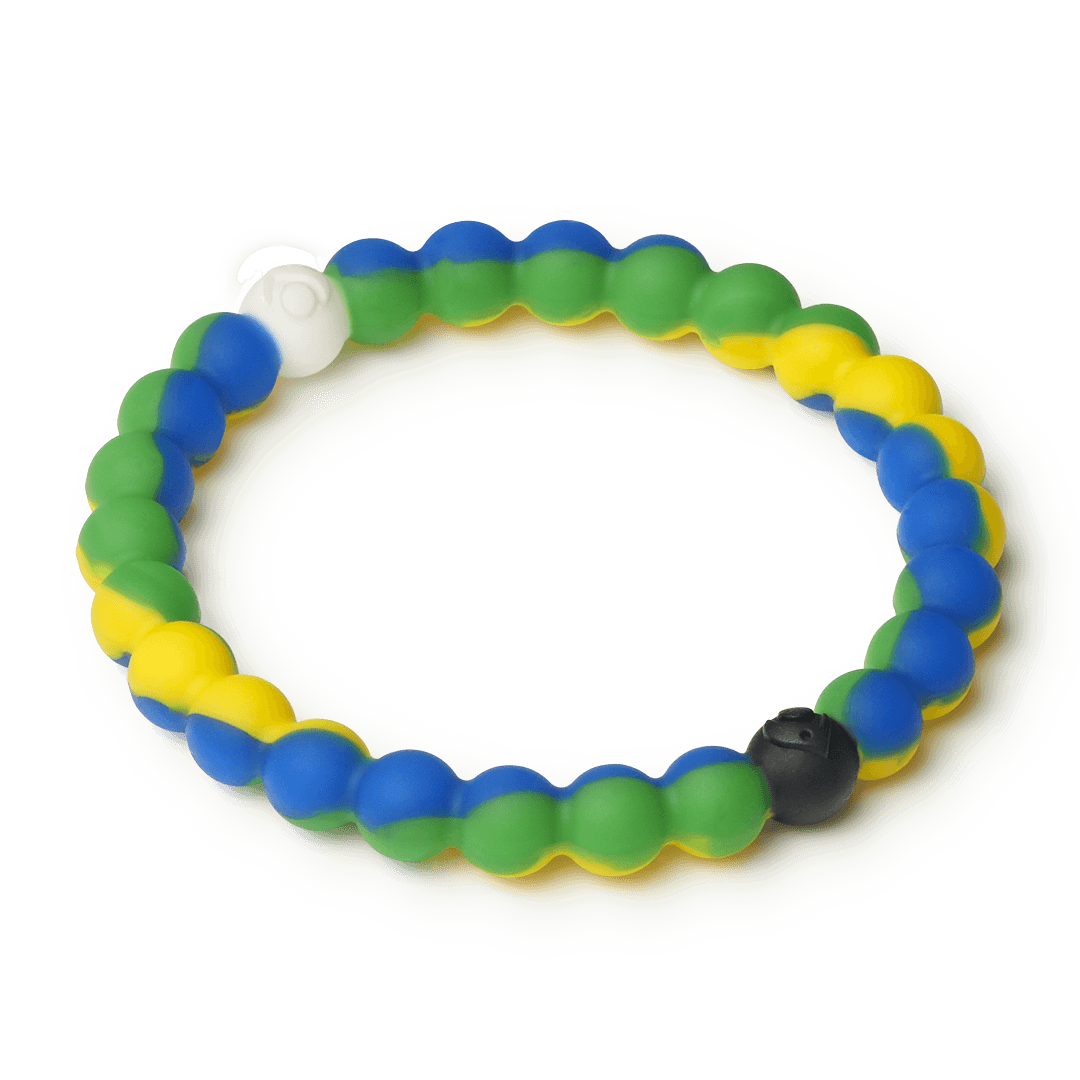 Side angle of green, yellow and blue swirl silicone beaded bracelet.