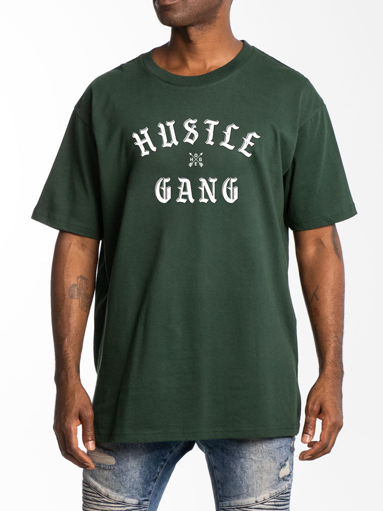 The Hustle Gang Face Off Crew Tee in Forest Green